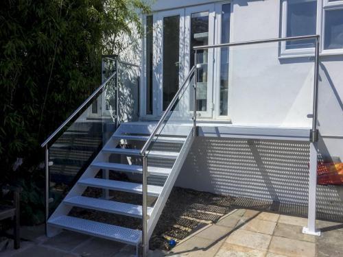 Cast Iron Balcony with Glass Balustrade