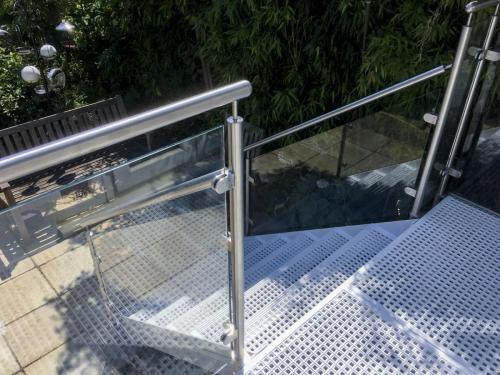 Cast Iron Balcony with Glass Balustrade